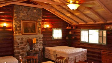 The interior of a rustic login cabin