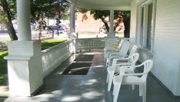 Glen Manor front porch in downtown Watkins Glen